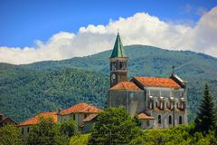 Rural landscape with church in Maddalena. Liguria, Italy with alpine background Royalty Free Stock Photo