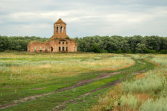 Rural landscape with church. Thrown old church on a green countryside meadow stock photos