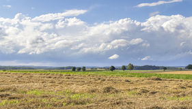 Rural landscape with clouds Stock Photos