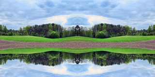 Rural landscape (double mirror effect). Royalty Free Stock Photos
