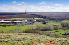 Rural landscape with a drilling tower on the horizon. View from above Royalty Free Stock Images