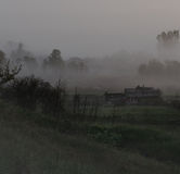 Rural landscape in  early morning fog Stock Images