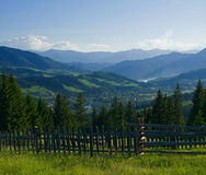 Rural landscape at early morning with mountains Stock Photo
