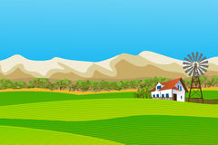 Rural landscape. With  farm and mountains background Stock Photography