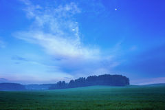 Rural Landscape with Field at Twilight Royalty Free Stock Images