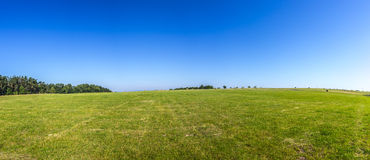 Rural landscape with fields and blue sky Stock Photography