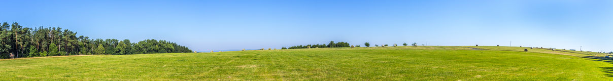 Rural landscape with fields and blue sky Stock Photo