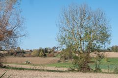 rural landscape with fields and tractor plowing on b Stock Images