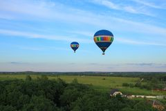 Rural landscape. Fly on the hot air balloons over the village Stock Image
