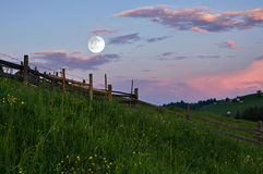 Rural landscape with a full moon Royalty Free Stock Image