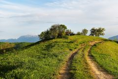 Rural landscape of green farm fields and country hillsides Stock Photography