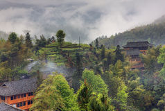 Rural landscape in the highlands of China, farmhouses ethnic vil Royalty Free Stock Photo