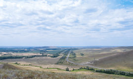 Rural landscape with highways, top view. Russia. Federal highway Orenburg - Orsk, view from the mountain Verblyuzhka. Russia, Orenburg region Royalty Free Stock Photo