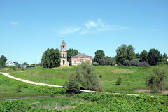Rural landscape with hills, river, a village and christian church ruins far away. Countryside landscape with hills, river, a village and christian church ruins Royalty Free Stock Photography