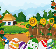 Rural landscape with house and painted Easter eggs Stock Photos