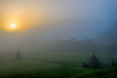 Rural landscape with house in summer sunrise light somewhere in Transylvania. Romania Stock Images