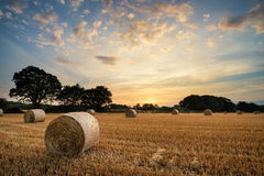 Rural Landscape Image Of Summer Sunset Over Field Of Hay Bales Stock Images
