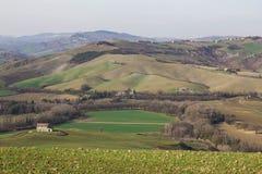 Rural landscape with isolated farmhouse. Near Urbino, Marche Stock Photos