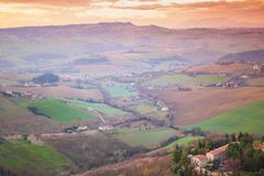Rural landscape of Italian countryside. In springtime. Province of Fermo, Italy. Villages and fields on hills royalty free stock photos