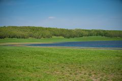 Rural landscape with lake in the distance royalty free stock image