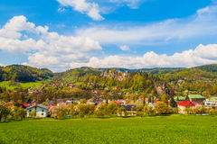Rural landscape with lush green meadow, blue sky and white clouds at Mala Skala in Bohemian Paradise, Czech Republic Royalty Free Stock Images