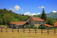Rural landscape in Maddalena, Italy. Rural landscape in Maddalena, Liguria, Italy with alpine background in the summer Stock Images
