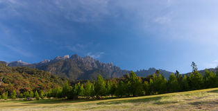 Rural landscape with Mount Kinabalu at the background in Kundasang, Sabah, East Malaysia Royalty Free Stock Photo