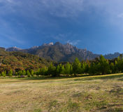 Rural landscape with Mount Kinabalu at the background in Kundasang, Sabah, East Malaysia Royalty Free Stock Image