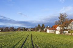 Rural landscape in Munich with new settlement and fields. Rural landscape in Munich with new settlement and green fields Royalty Free Stock Photos