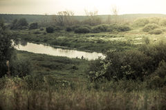 Rural  landscape with narrow river during sunrise Stock Photo