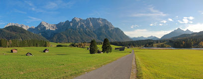 Rural landscape near mittenwald, farmland with huts Royalty Free Stock Photos