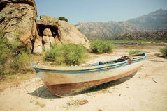 Rural landscape with old fishing boat on the dry land of beach,  lake Bafa, rural Turkey. Stock Photography