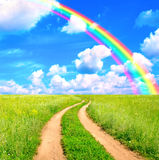 Rural landscape with old road and rainbow Royalty Free Stock Images