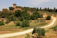 Rural landscape with old tower, Tuscany, Italy. Rural landscape with old tower and country road, Tuscany, Italy royalty free stock photo