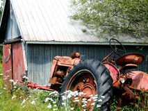 Old Tractor and Barn Stock Image