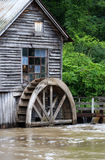Rural landscape with old wooden watermill in woods. Royalty Free Stock Photos