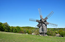 Rural landscape with old wooden windmill Stock Image