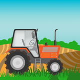 Rural landscape with orange  tractor Stock Photo