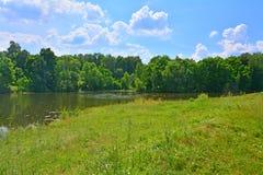 Rural landscape with a pond in Darovoye estate of Dostoyevsky Royalty Free Stock Photos