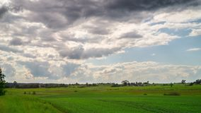 Rural landscape and rain clouds, time-lapse stock video