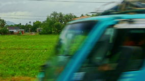 Rural landscape rice fields villages roads against cloudy sky stock video