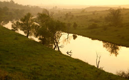 Rural landscape, the river at sunset in the fog Royalty Free Stock Photos