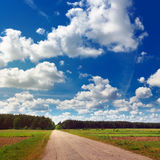 Rural landscape with road and clouds Stock Photography