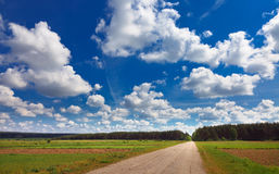 Rural landscape with road and clouds Stock Photo