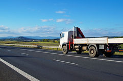 Rural landscape with road and moving truck Stock Image