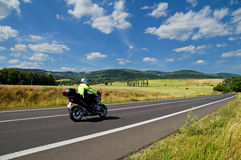 Rural landscape with road you are riding a motorcycle Royalty Free Stock Image