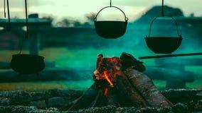 Bonfire with rustic iron pots