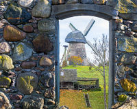 Rural landscape seen trough a door of old building Royalty Free Stock Photography