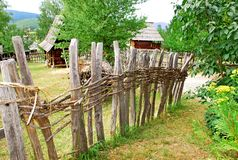 Rural landscape Serbia. Ethnic Serbia, wooden house behind fence over rural landscape Stock Photos