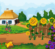 Rural landscape with a small house. With a thatched roof. Wooden fence with flowers and a chick in a nest in the foreground Stock Images